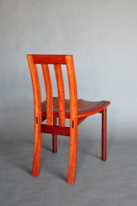 Solid Pod wideback chair in ligh Jarrah