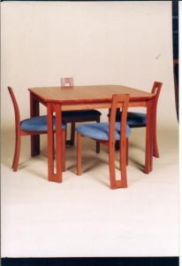 Square Pod table and Pod chairs, jarrah
